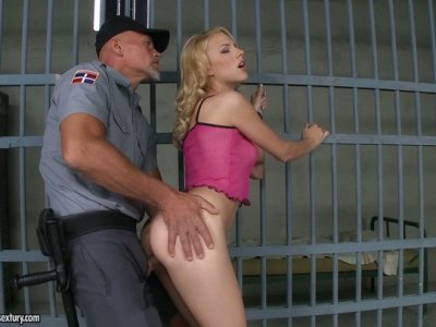 Blond curly prisoner Berinice sucks the cock of the cop