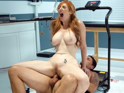 Redhead Lauren Phillips rides the hard rod with her trimmed twat